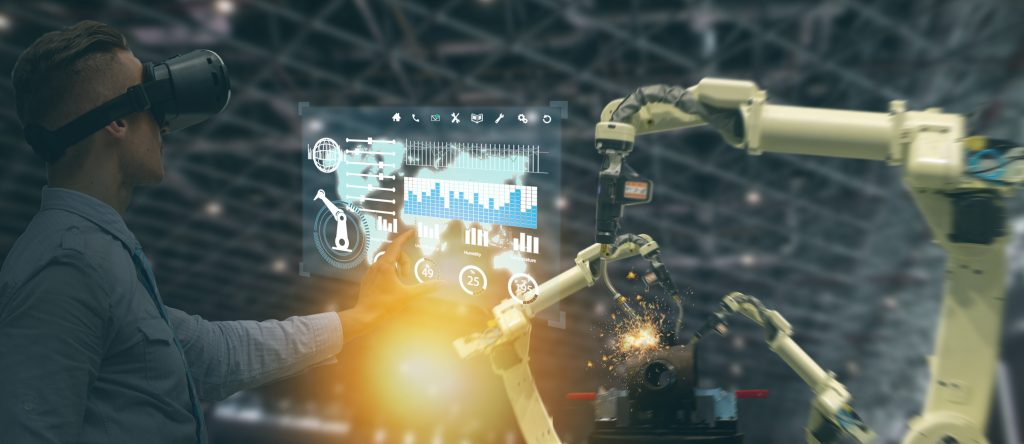 iot industry 4.0 concept,industrial engineer(blurred) using smart glasses with augmented mixed with virtual reality technology to monitoring machine in real time.Smart factory use Automation robot arm (Bild: ©ekkasit919/Fotolia)